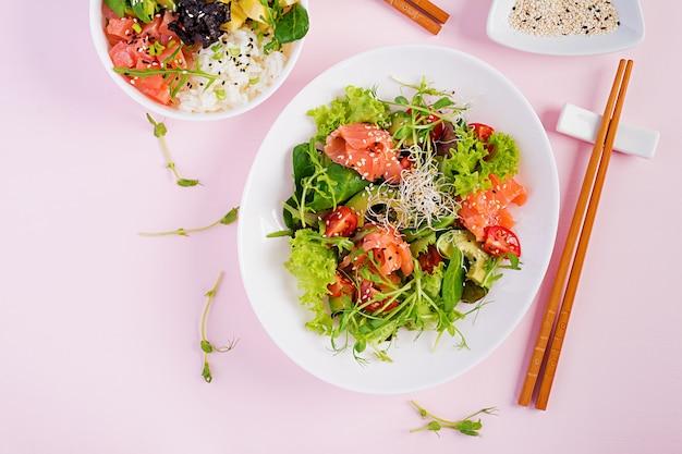Healthy breakfast. buddha bowl with rice, mango, avocado and salmonnd salmon sandwich with avocado Premium Photo