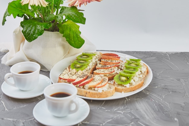 Healthy breakfast coffee, bouquet of flower and toasts Premium Photo