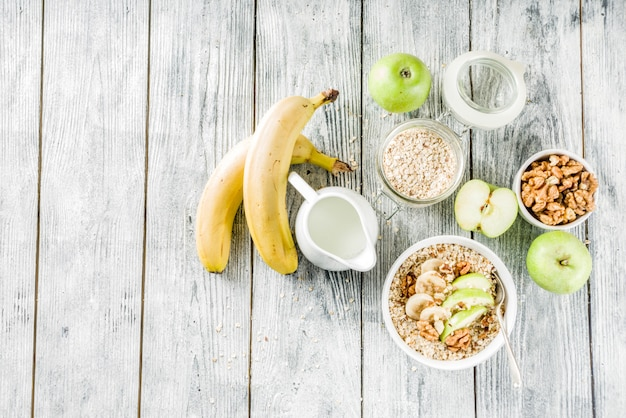 Healthy breakfast oatmeal with nuts ad fruits Premium Photo