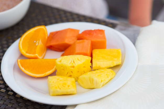 Healthy breakfast on the table closeup in outdoor cafe Premium Photo