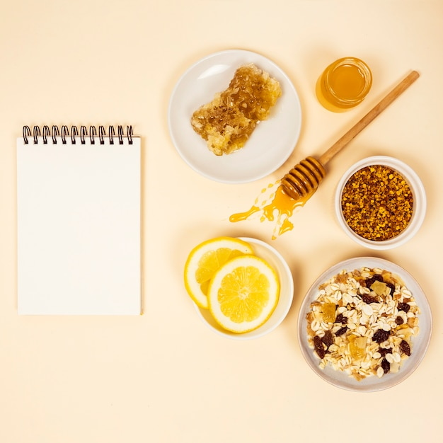 Healthy breakfast with blank spiral diary Free Photo