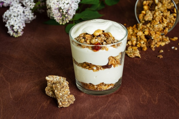Healthy breakfast with granola and homemade yogurt in a glass. Premium Photo