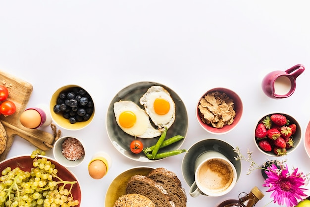 Healthy breakfast with muesli, fruits, nuts on white background Free Photo