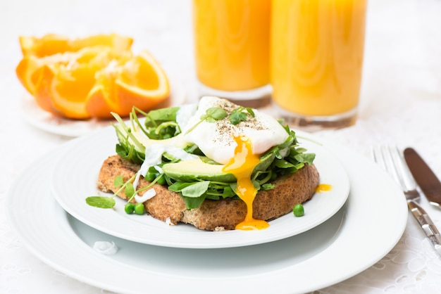 Healthy breakfast with wholemeal bread toast and poached egg Premium Photo