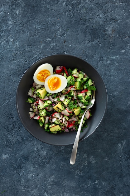 Healthy brunch salad with eggs top view Premium Photo