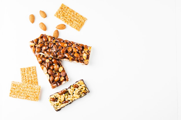 Healthy cereal and almonds proteins bars against white background Free Photo