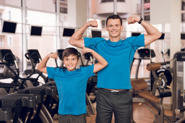 Healthy dad and son show off musculature. Premium Photo