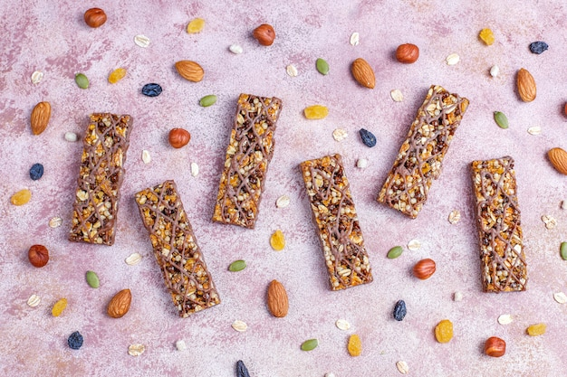 Healthy delicios granola bars with chocolate,muesli bars with nuts and dry fruits,top view Free Photo
