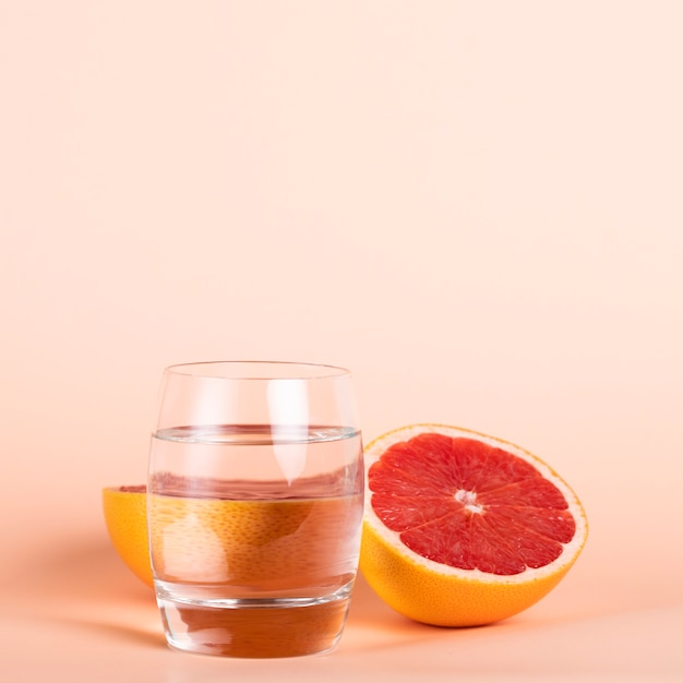 Healthy delicious fruit with glass of water Free Photo