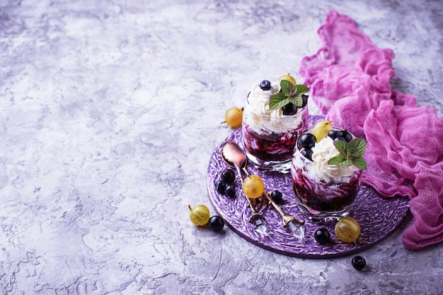 Healthy dessert with berry and cream cheese. selective focus, space for text Premium Photo