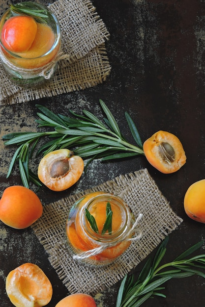 Healthy detox drink apricot with rosemary. Premium Photo