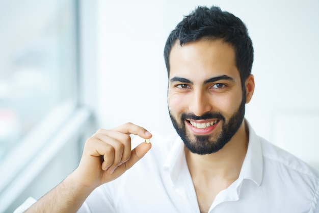 Healthy diet. nutrition. vitamins. healthy eating, lifestyle. man with fish oil capsules Premium Photo