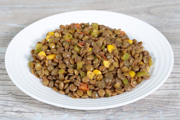 Healthy dietary food. boiled lentil with corn and vegetables Premium Photo