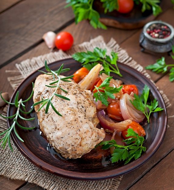 Healthy dinner - healthy baked chicken breast with vegetables on a ceramic plate in a rustic style Free Photo