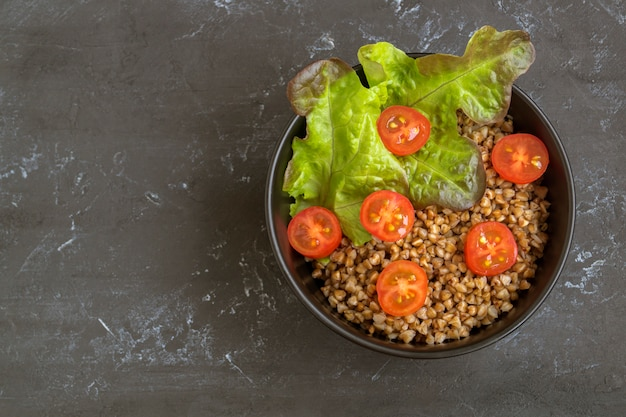 Healthy dish with buckwheat and vegetable salad. buddha bowl. balanced food. delicious detox diet.top view Premium Photo