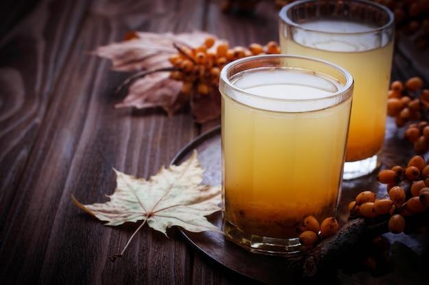 Healthy drink with sea buckthorn Premium Photo