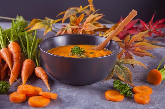 Healthy eating carrot cream soup. Premium Photo