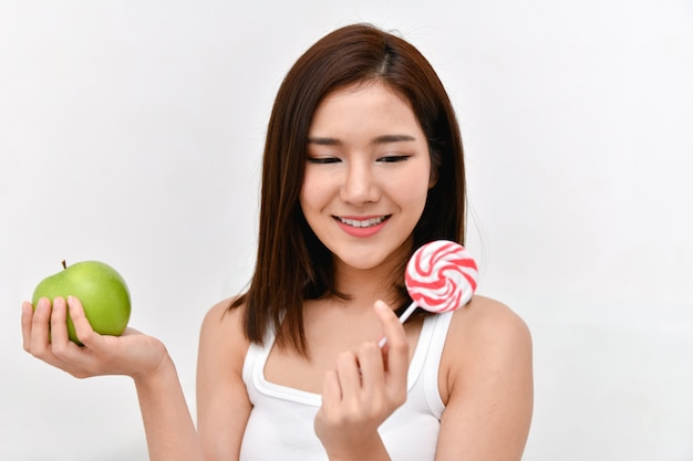 Healthy eating concept. beautiful girls are choosing to eat with their hands. Premium Photo