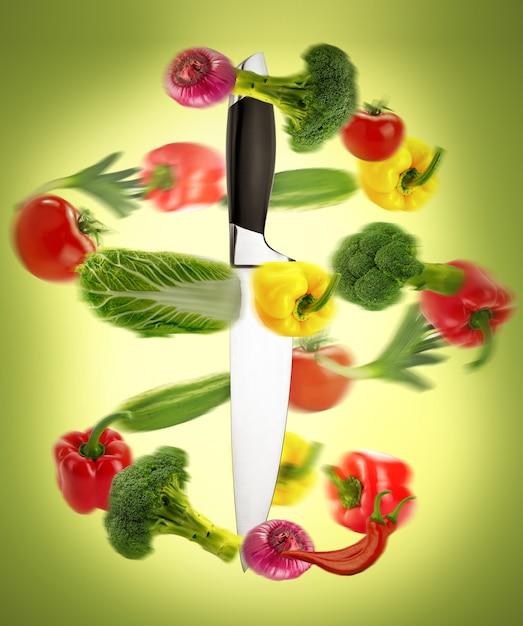 Здоровое питание, нож с овощами Premium Фотографии