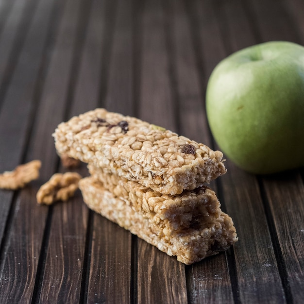 Healthy energy bars and apple Free Photo