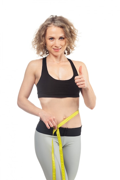 Healthy female body with measuring tape Premium Photo