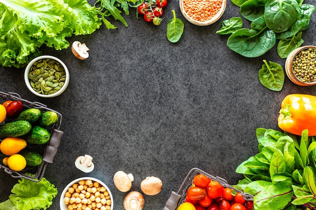 Healthy food background. autumn fresh vegetables on dark stone table with copy space, top view Premium Photo