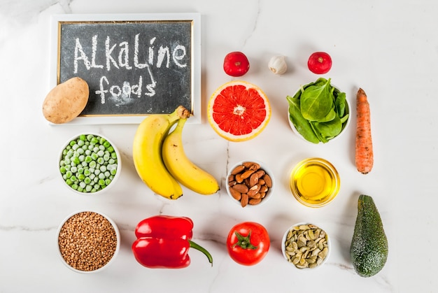 Healthy food background, trendy alkaline diet products - fruits, vegetables, cereals, nuts. oils above Premium Photo