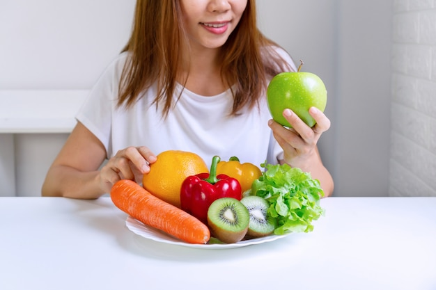 Healthy food clean eating selection fruits, vegetables on white table background. selection of healthy food. clean eating concept. Premium Photo