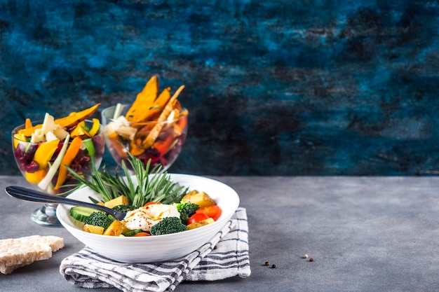 Healthy food composition with colorful salad Free Photo