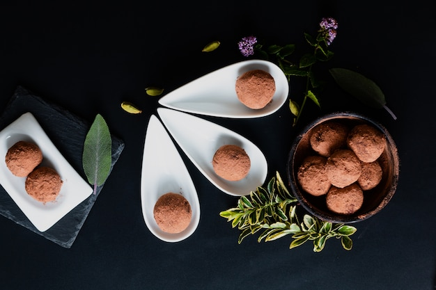 Healthy food concept homemade chocolate truffle on black Premium Photo