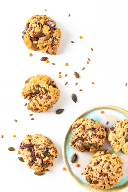 Healthy food concept homemade trail mix organic whole grains energy cookies on white background with copy space Premium Photo