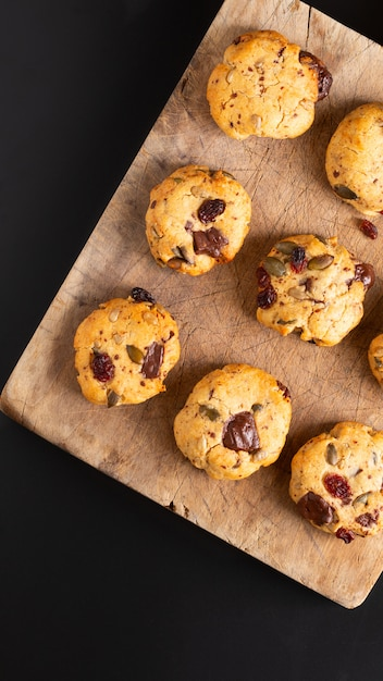 Healthy food concept homemade trail mix organic whole grains energy cookies on wooden board with copy space Premium Photo