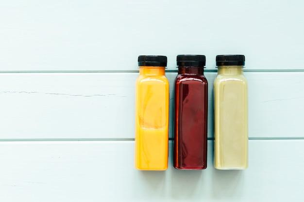 Healthy food concept with three juices Premium Photo