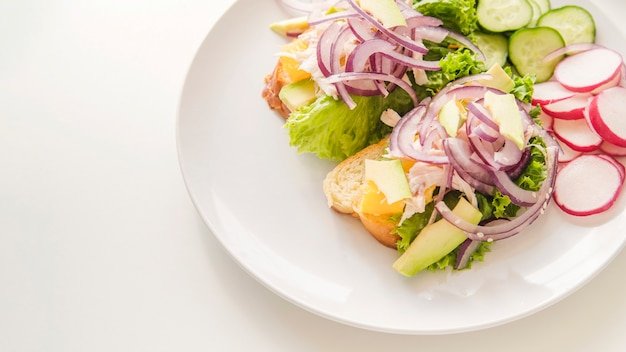 Healthy food on plate with copy-space Free Photo