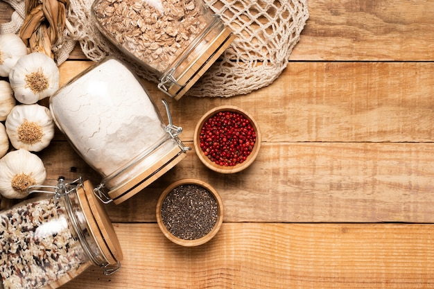 Healthy food and seeds on wooden background with copy space Free Photo