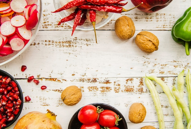 Healthy food on white weathered wooden table Free Photo