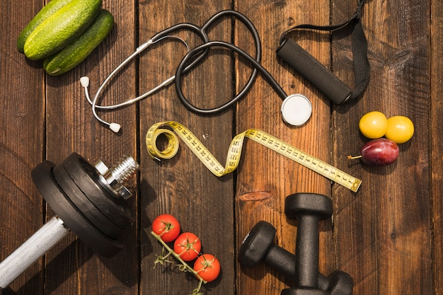 Free Photo | Healthy food with exercise equipment; measuring tape and  stethoscope