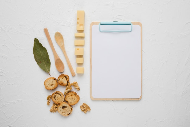 Healthy food with wooden blank clipboard on concrete backdrop Free Photo