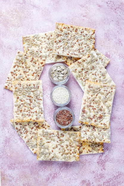 Healthy fresh baked gluten free crackers with seeds. Free Photo