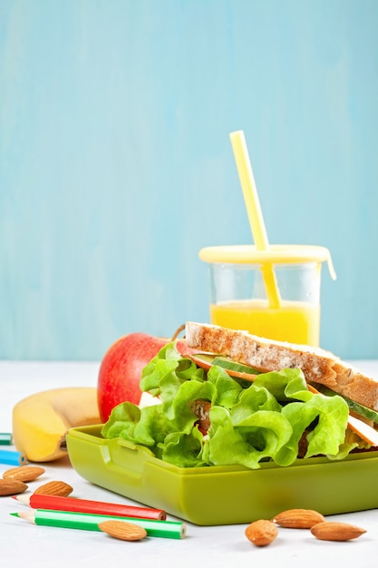 Healthy and fresh sandwich, apple and orange juice for student lunch Premium Photo