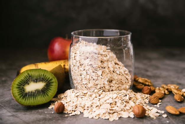 Healthy fruit and oats breakfast Free Photo