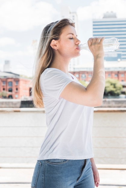 Healthy girl drinking water Free Photo