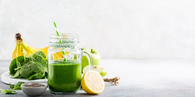 Healthy green smoothie with spinach in glass jar Premium Photo