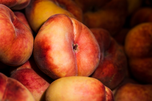 Healthy harvest peaches in market for sales Free Photo