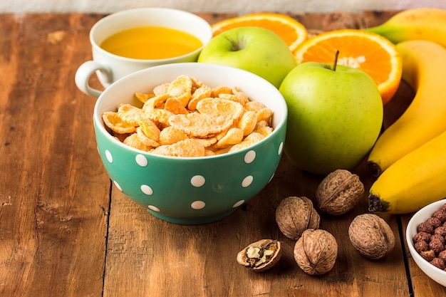 Healthy home made breakfast of muesli, apples, fresh fruits and walnuts Free Photo