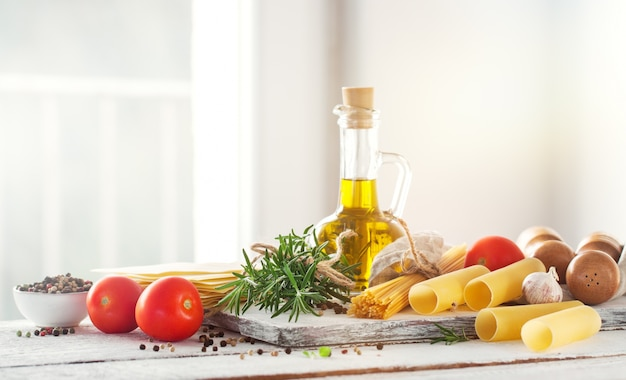 Healthy ingredients on a kitchen table spaghetti olive oil t
