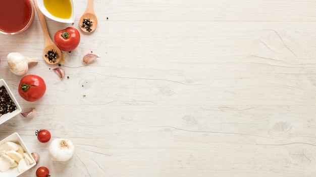 Healthy ingredients on white wooden desk Free Photo