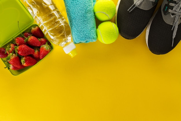 healthy life sport concept sneakers with fruits towel