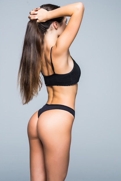 Healthy lifestyle diet and fitness. beautiful slim woman's body. perfect slim toned young body of the girl. fitness or plastic surgery and aesthetic cosmetology. taut elastic ass. firm buttocks Free Photo