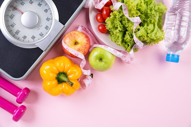 Healthy lifestyle, food and sport concept on pink pastel background. Premium Photo